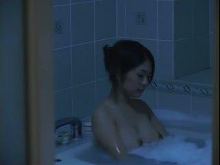 Big tit Asian taking bath
