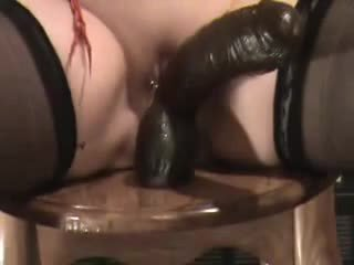 Wife with a big black toy