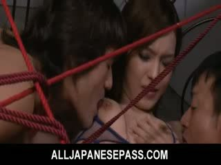 Mei Haruka is tied up and takes three dongs in her cunt and mouth.