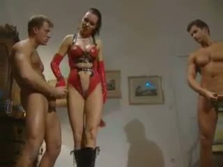 Leather dressed babe fuck two guys