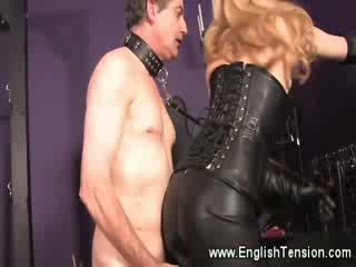 Strict leather domina allows masturbation