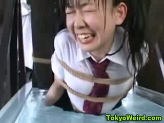 oriental prostitute tied to water wheel and taunted