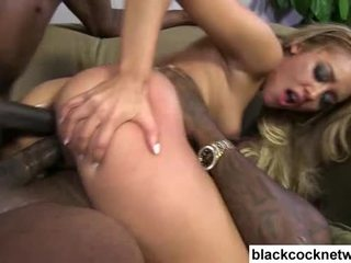 Two black cocks force their way into blondes holes Video