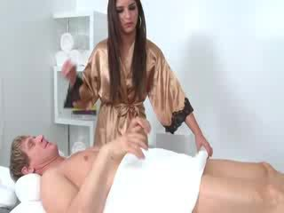 Dark haired masseuse with mouthful of dong from her client
