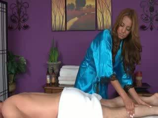 Brunette masseuse sucking cock for her client