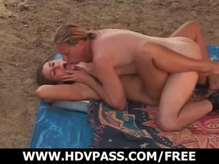 Sunbathing turns into sex on the sandy beach