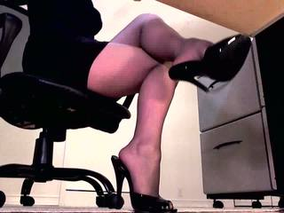 Dominant erotic hypnotist sexily dangles her st...