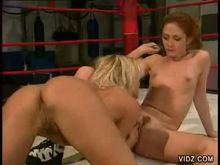 Two sexy gals in boxing ring sexcapade