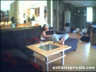 Voyeuring mom fingering on the sofa Video