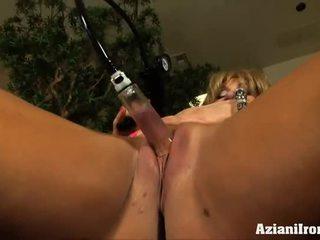 Big muscles, big klitoris and a kompa to make it bigger