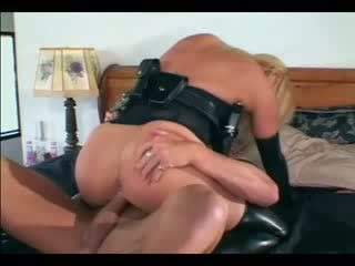 Sexy blonde female cop in uniform and latex gloves fucking a guy