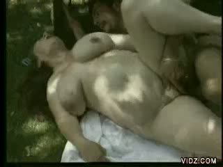 Preggy brunette babe rides cock by the pool