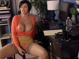 Busty brunette mature spreads her legs and gets a meaty sausage shoved up her twat