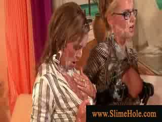 Bukkake loving Lezboes getting wet and messy with slime shower