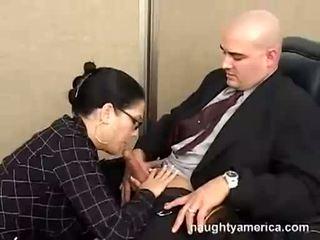 Black haired Reina Leone sucking her boss meaty cock in the office