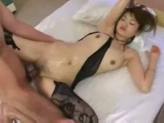 Oily asian babe gives footjob and get fucked with facial cum
