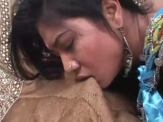 Indian slut rides a cock deep in her hairy cunt