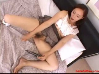 Busty milf with tied arms giving blowjob fucked on the bed