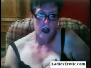 Old granny with glasses on webcam skype