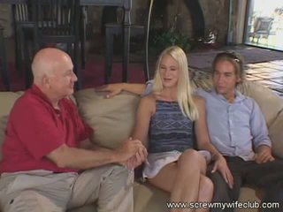 Blonde wife fucks her husband in front of a group