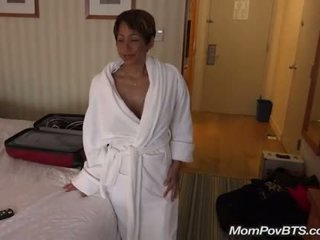 Busty asian MILF behind the scenes