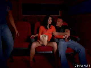 Naughty girl has sex with two guys in cinema