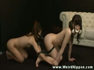 Asian sex slaves tied together crawl o...