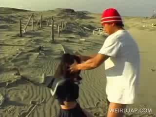 Asian school cutie forced to give blow...