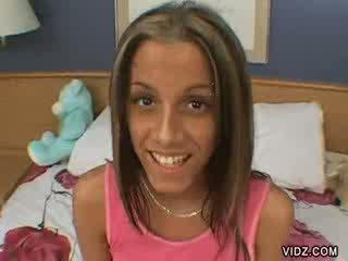 Flamboyant brunette chick eats nut juice