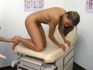 Beauty couple fun with long strapon at docs office
