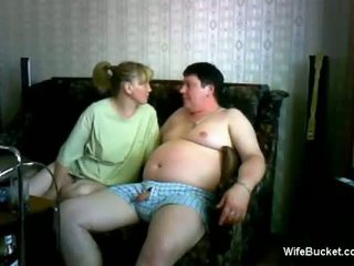 Mature wife gives a funny blowjob to hubby