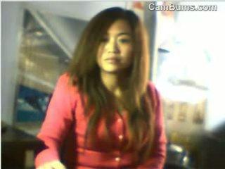 中国の 女の子 flashes 彼女の ティッツ